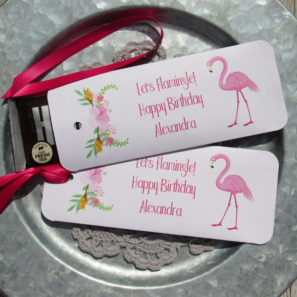 New to our store our Flamingo Party Favors that can be personalized with the honoree's name. Each candy bar holder is printed on white card stock with a fuchsia ribbon,