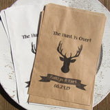 Personalized rustic wedding favor bags adorned with a deer head,