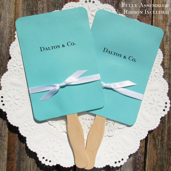 An elegant take on the hand fan , these Tiffany Blue favor fans