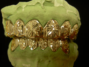 sunburst gold grill