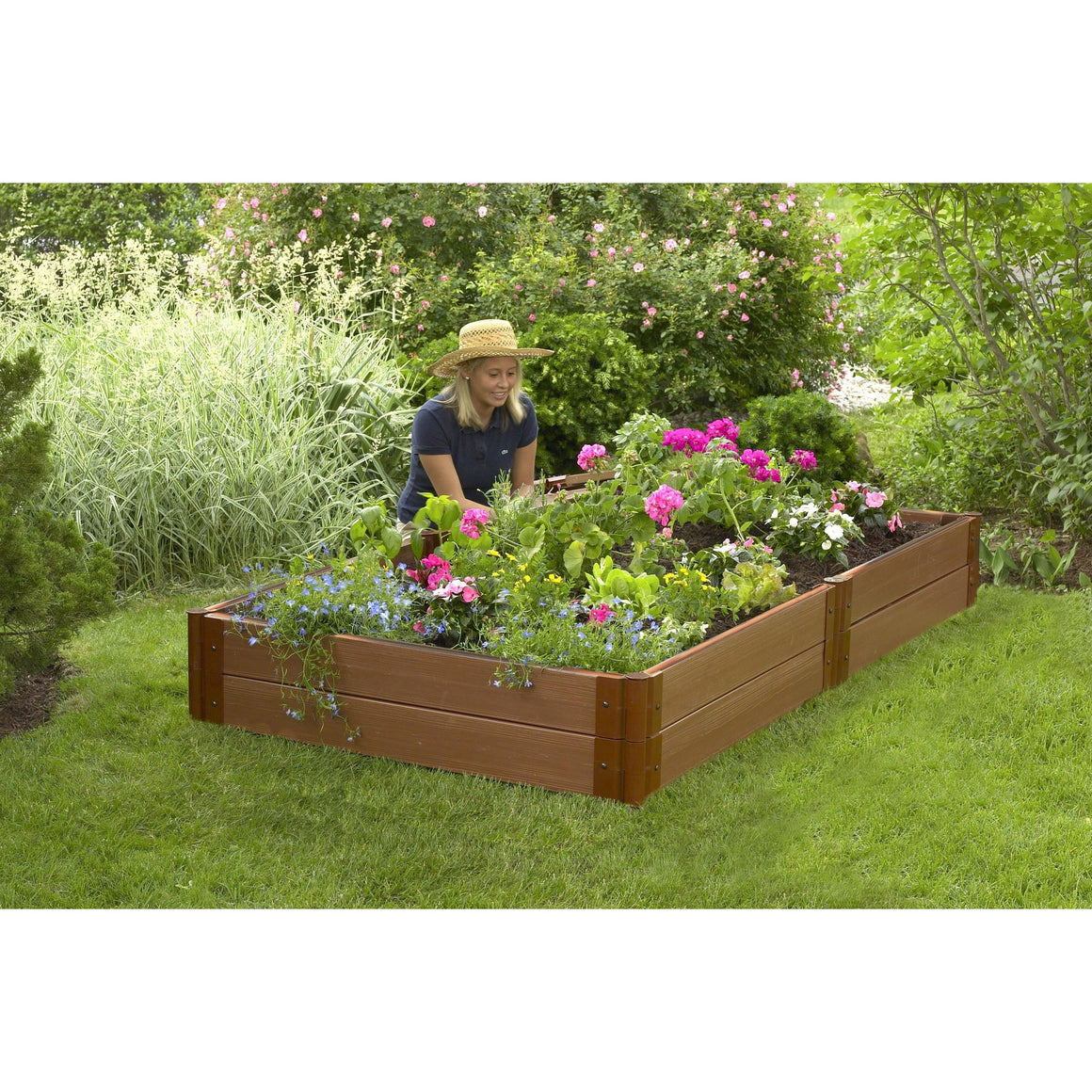 "Raised Garden Bed-Composite 4'X8' Rectangle 2 Level (1"" Profile) Shown on lawn planted with woman kneeling planting"
