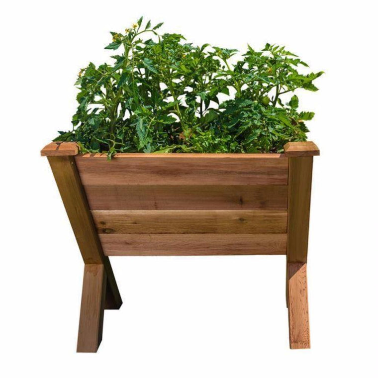 "Gronomics ECO Cedar Garden Wedge 30"" W x 34""L x 32""H front view shown against white background filled with plants"