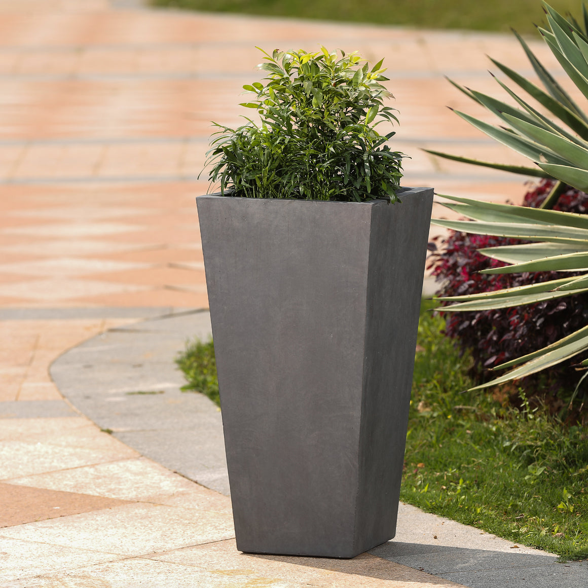 Garden Planter - Tapered Stone Finish Tall Planter (Medium) on paved patio planted with greens