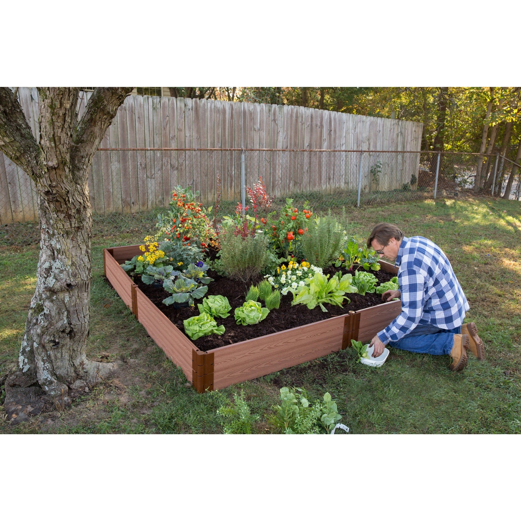 Beau ... Raised Bed Kit, Frame It All Composite Classic Sienna In Garden Setting  Man Kneeling Planting