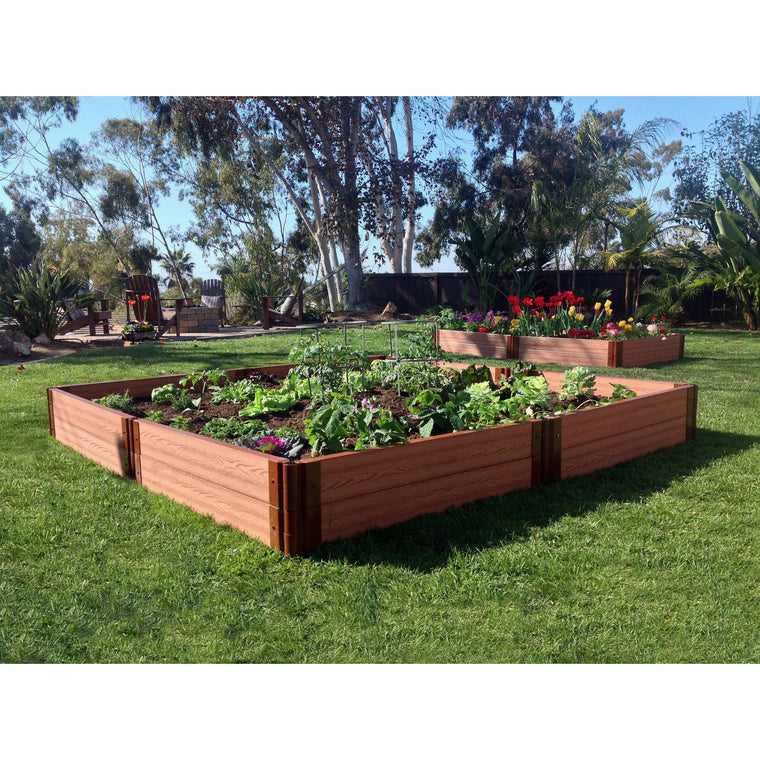 Raised Garden Bed - Composite Square shown on lawn filled with plants