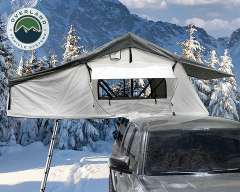 Roof Top Tent Extended 3 Person Roof Top Tent With Annex White/Dark Gray Rain Fly Black Cover Nomadic Arctic Overland Vehicle Systems