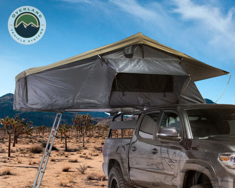 Roof Top Tent 3 Person Extended Roof Top Tent Dark Gray Base With Green Rain Fly With Bonus Pack Nomadic Overland Vehicle Systems