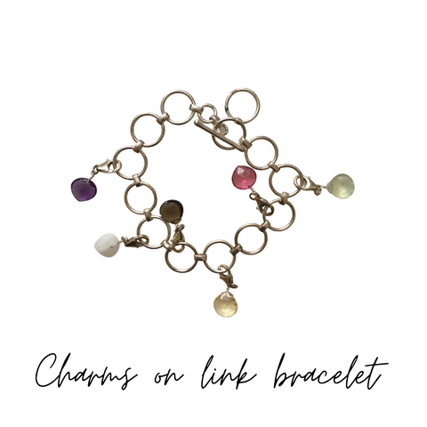 Link bracelet with charms