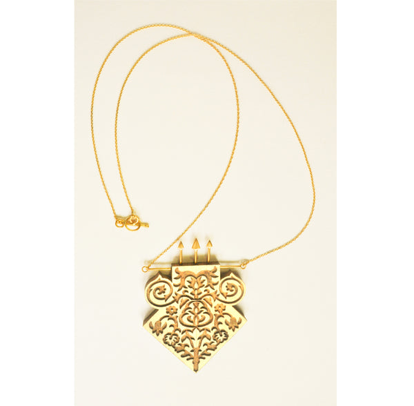 the seeker wood and gold tribal necklace on white background showing t bar closure clasp