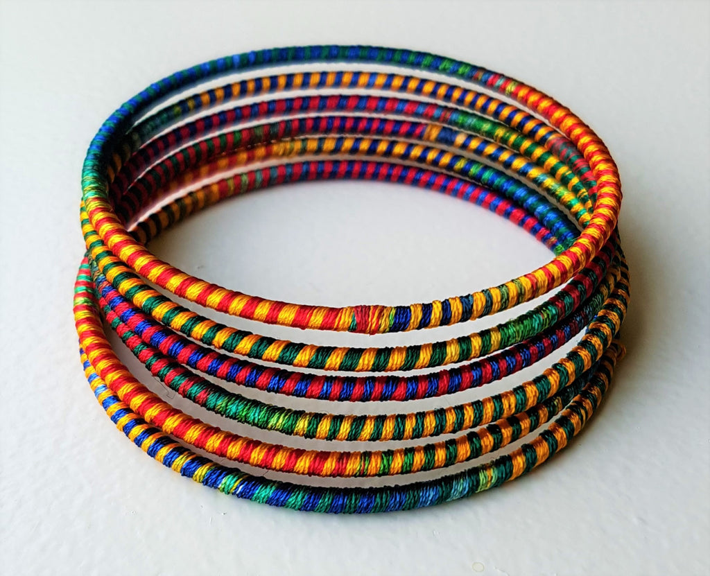 Stacked silk bracelets, a variation of colours