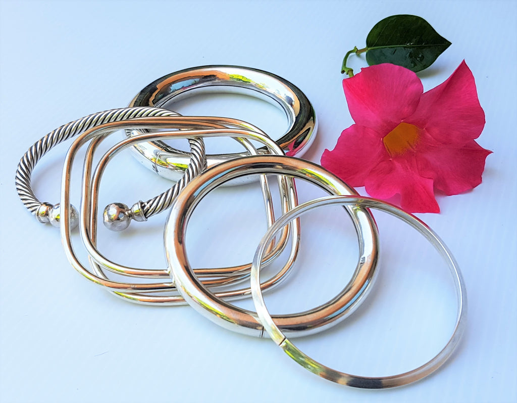 three square bangle in one shown in a grouping with other bracelets en argent