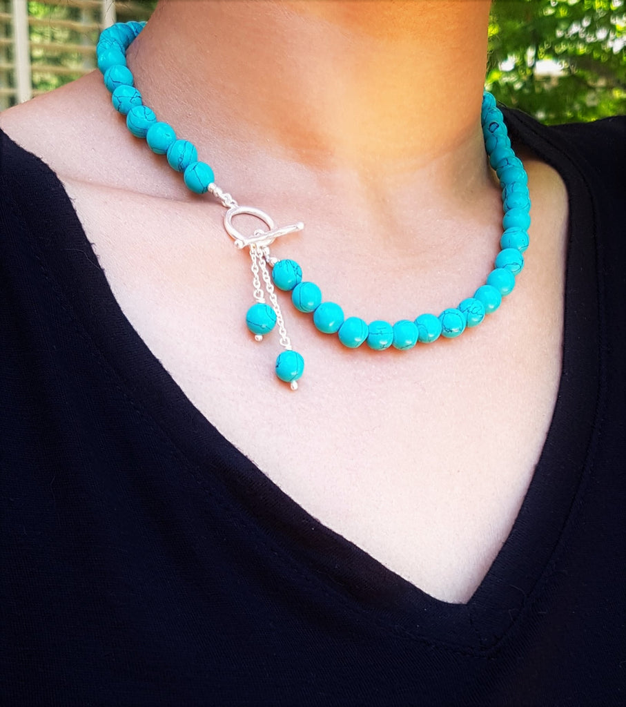 turquoise bead necklace with gold toggle clasp