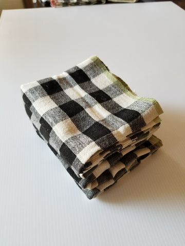 folded black and ivory with green edge handwoven table runner