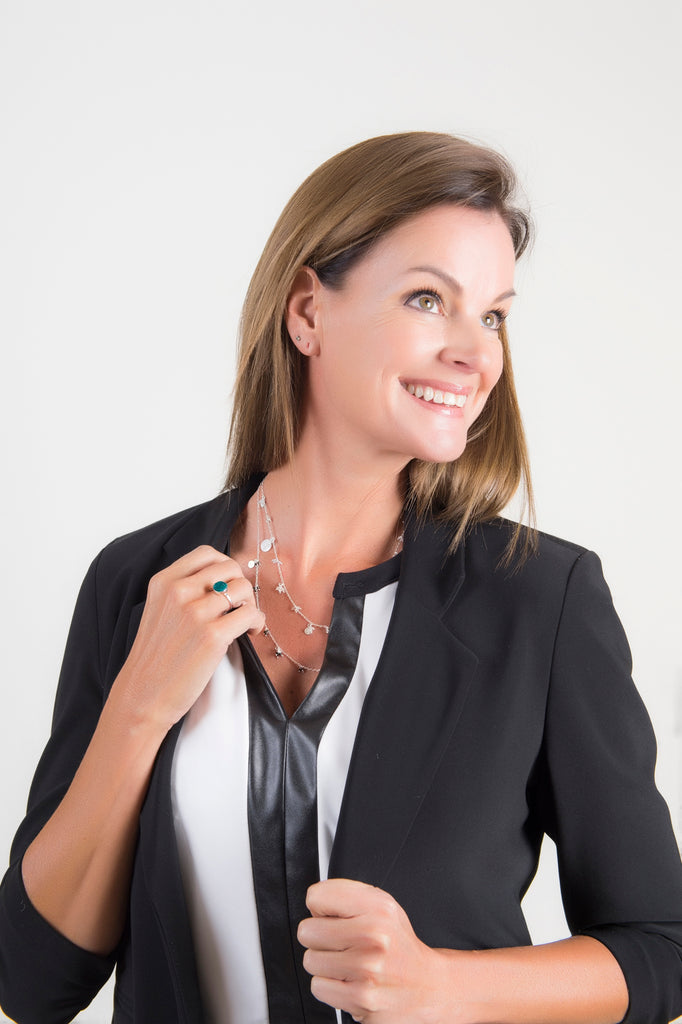 smiling model wearing dainty thank you india necklace with onyx stones and druzy ring