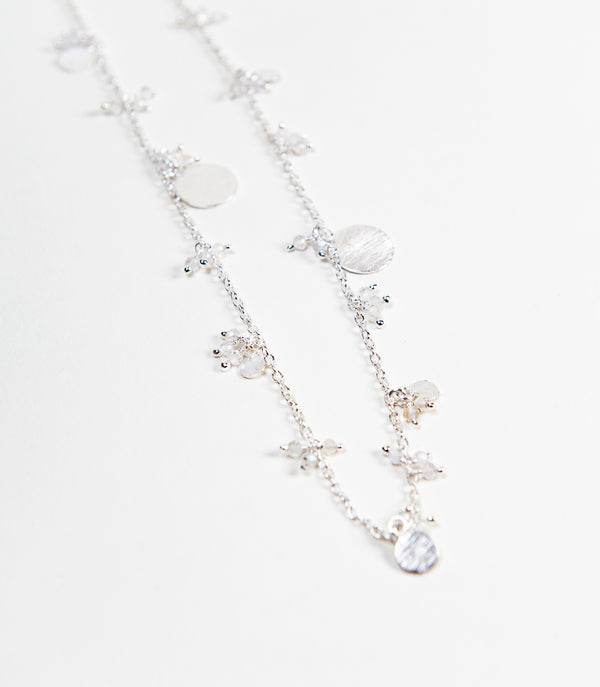 925 chain necklace with dangling crystal beads and circles that was designed in canada