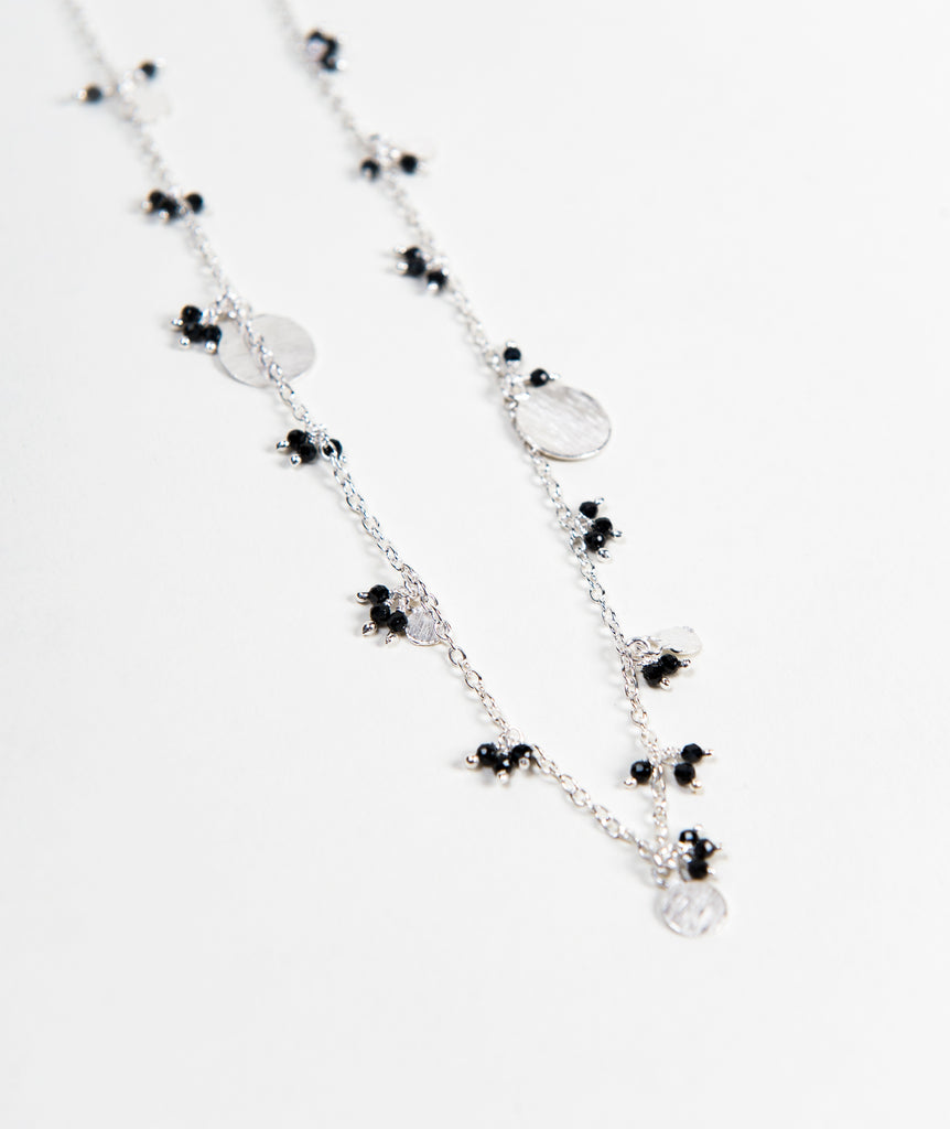 ethically made sterling silver necklace with dainty black onyx beads and hanging coin details