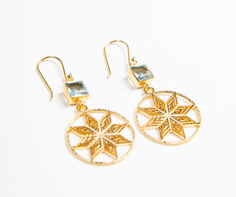 Gold hook earrings with hanging geometric star design and blue stone detail