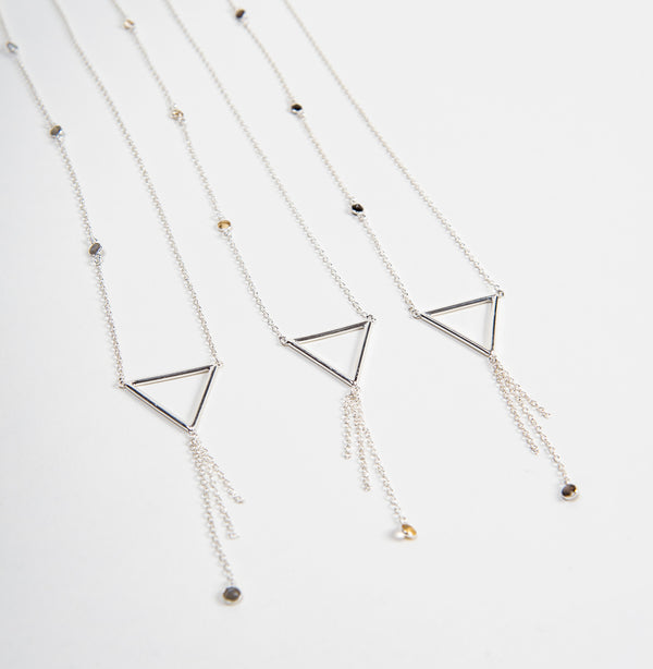 three long silver necklaces with geometric triangle shape and citrine, smoky topaz or labradorite stones