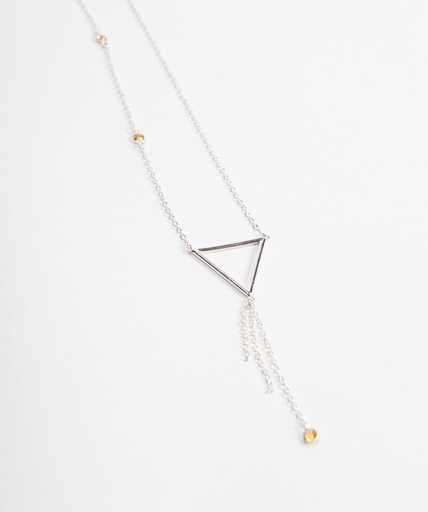 Beautiful shot of new sterling triangle necklace with small round citrine settings on chain and tassel