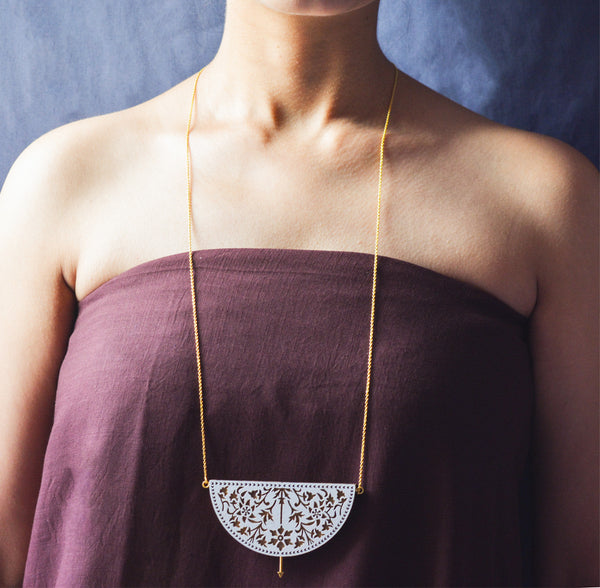 long teak wood and gold plated brass sacred sanctuary tribal necklace on female model