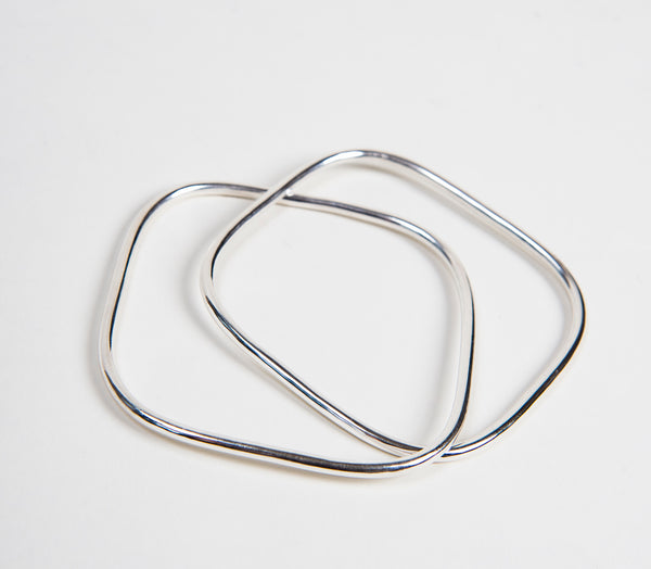two intertwined square sterling silver bangles that are ethically  made by thank you india