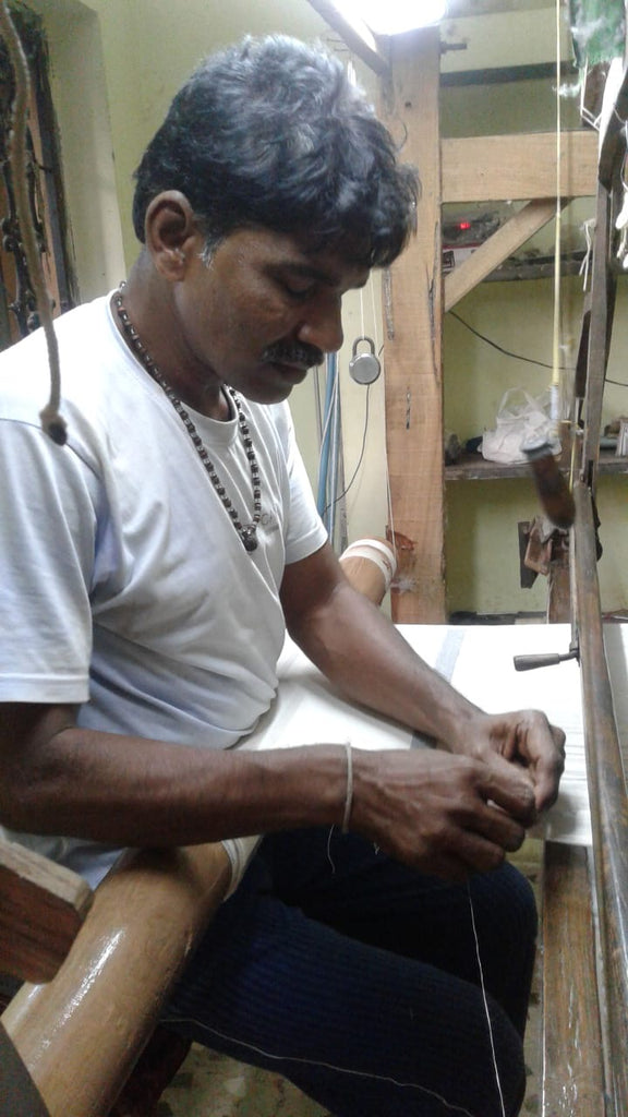 Vishnu the weaver artisan working on the striped napkin