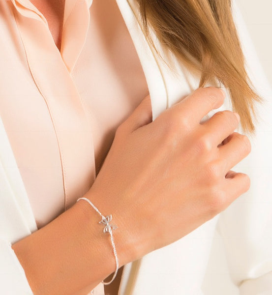 close up of female model wearing silver Hopewell butterfly bracelet