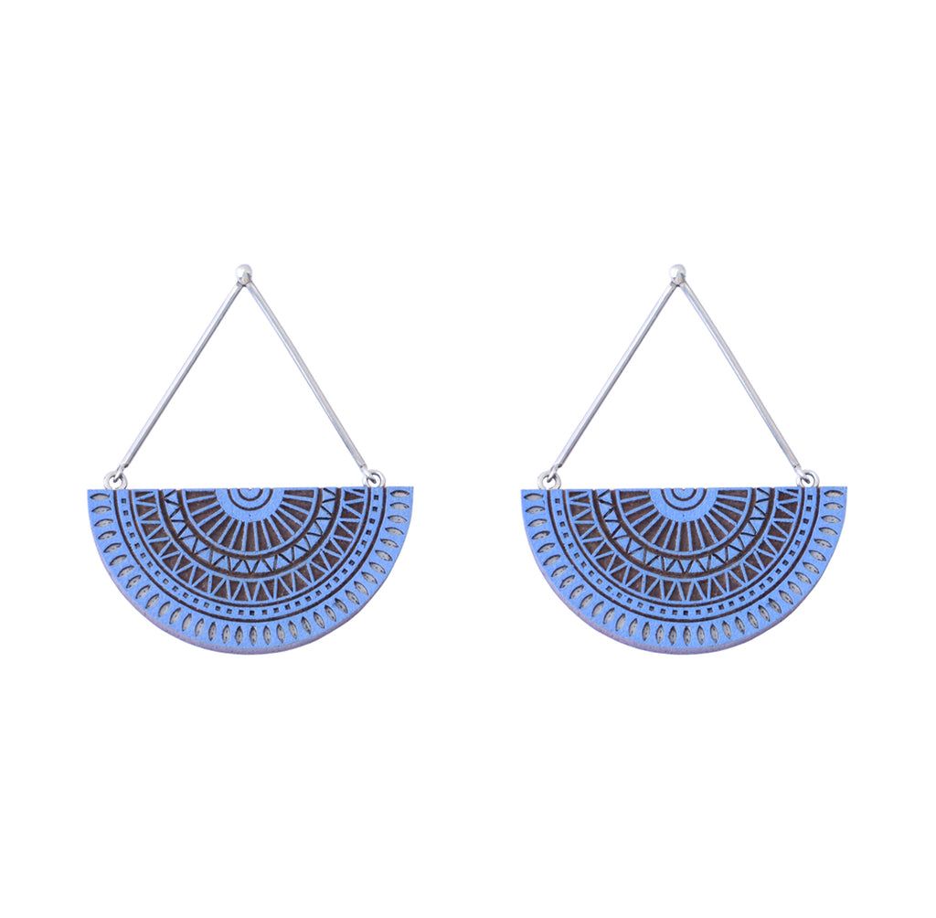 handcrafted natural indigo wood and silver chandratithi earrings on white background