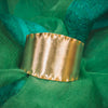 ruffled edge gold plated satin finish cuff for TYI styled on green scarf