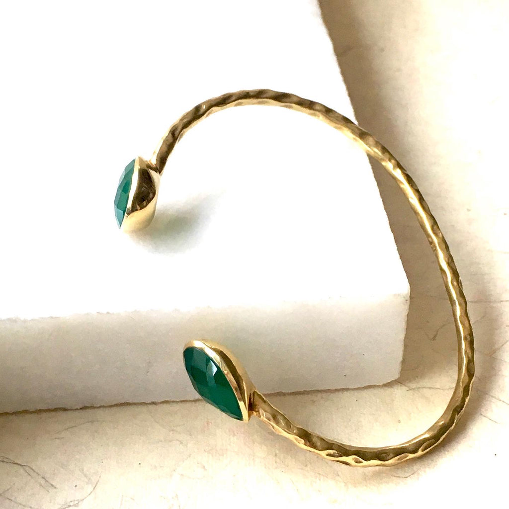 Close up shot of the Salima Gold Cuffs in Green Onyx by Thank You India