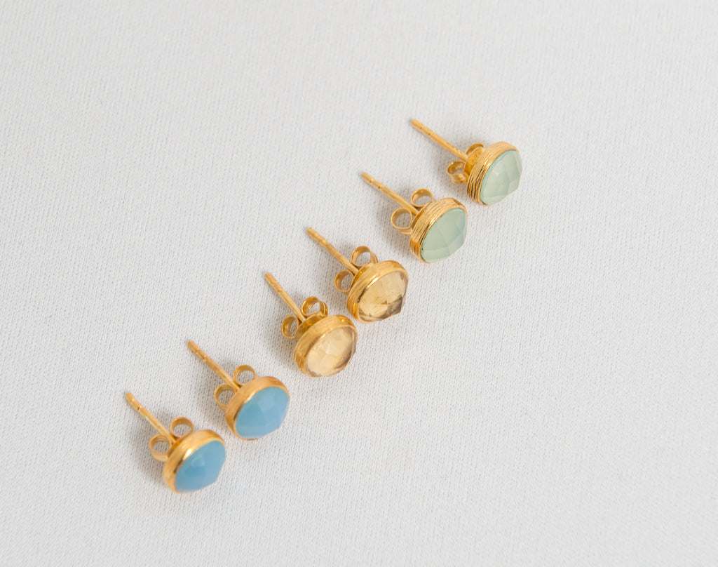 a collection of semi precious gold studs with semi precious stones by Thank You India