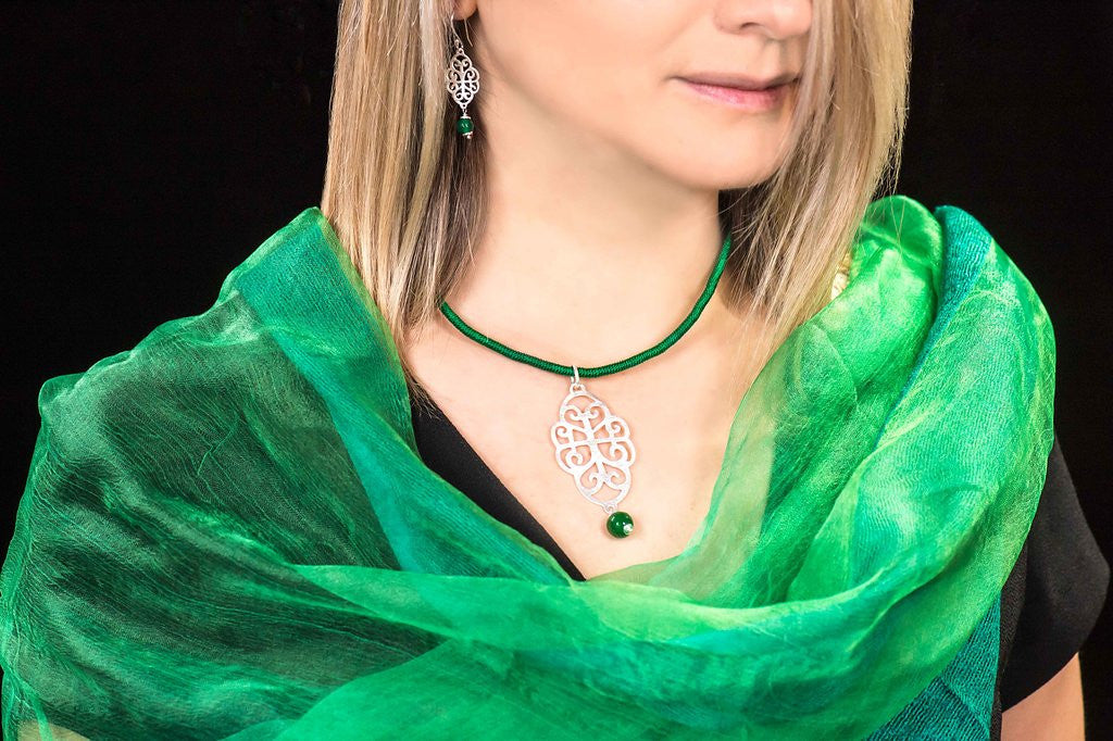 Silver filigree pendant necklace with green onyx drop and green silk strand