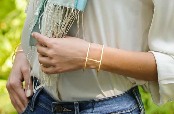 Close up view on model wearing the Mid Rib - Architectural Cuff - Gold on each wrist by Thank You India