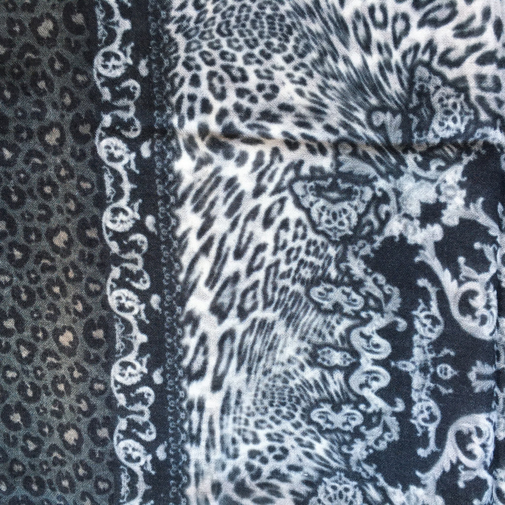 close up view of the  animal print scarf_ black & grays