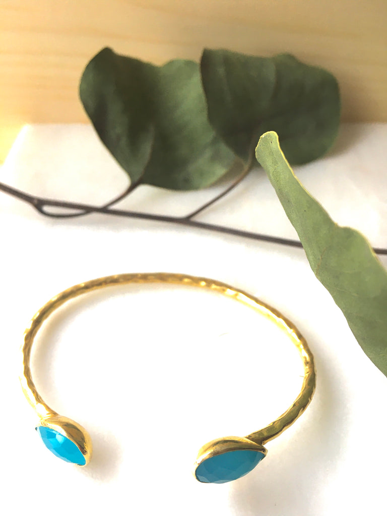 Close up shot of the Salima Gold Cuffs in blue chalcedony by Thank You India