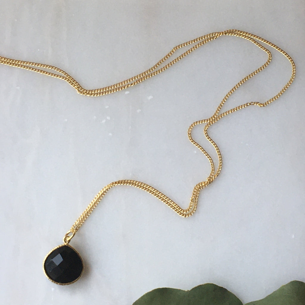Mary One Black Onyx  pear shaped stone on a gold chain