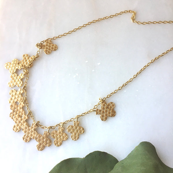 gold clover leaf necklace by Thank You India