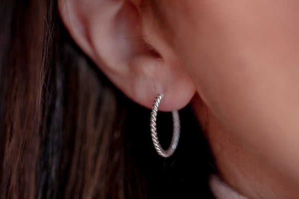 Close up shot on model  wearing the small Janet Braided Hoops in Sterling Silver from Thank You India