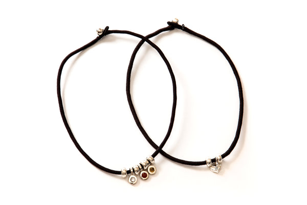 silver beads or slides on the black silk indora strand.  paired with birthstone beads
