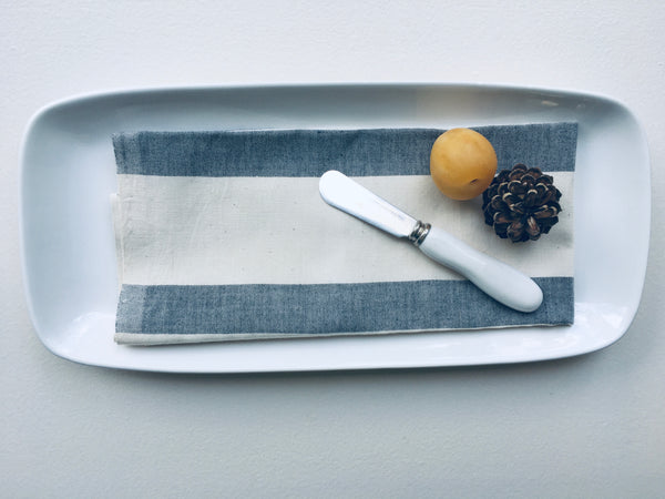 Muted Grey Strip Table Napkins placed on white plate made in India