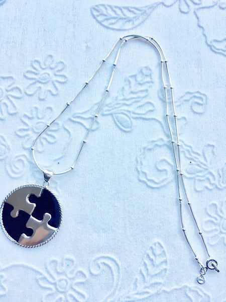 "QuickStart Autism Puzzle piece in black enamel and sterling silver.  The chain is ball and chain and is 20"" long"