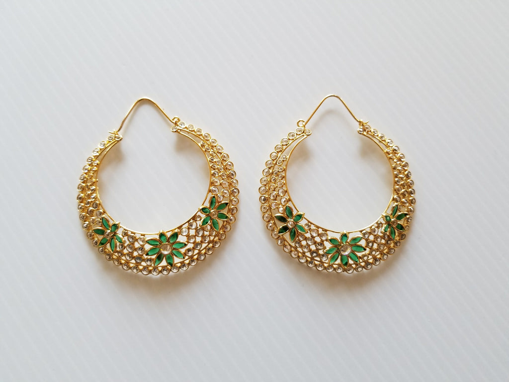 set of stunning gold and green hinged earrings with stones and flower design