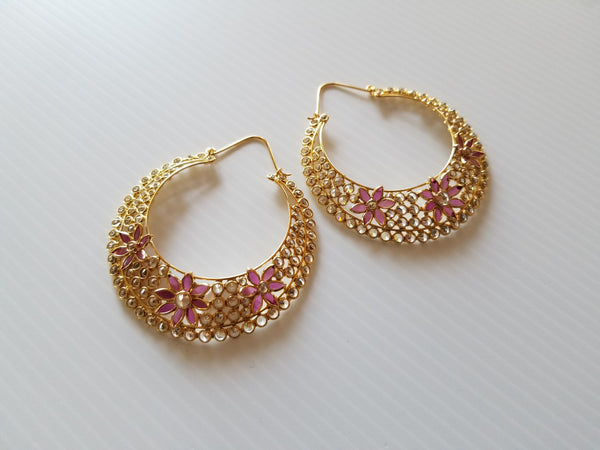 hinged hoop earrings with hold and pink crystal flowers
