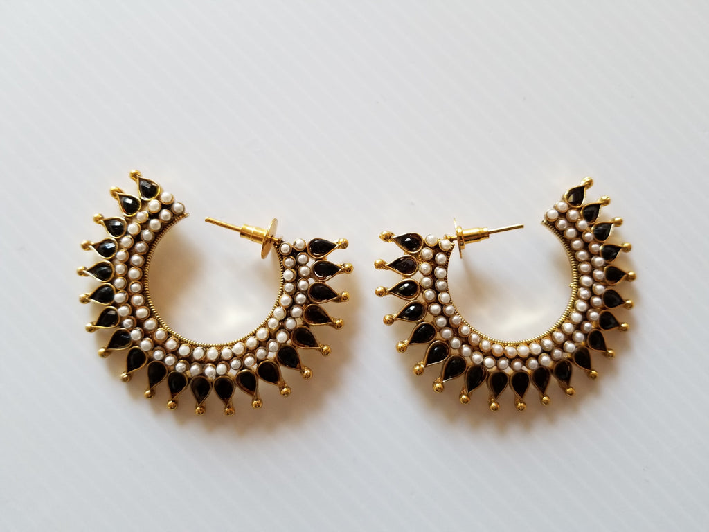 Black and gold bollywood style stud earrings with posts and spike detail