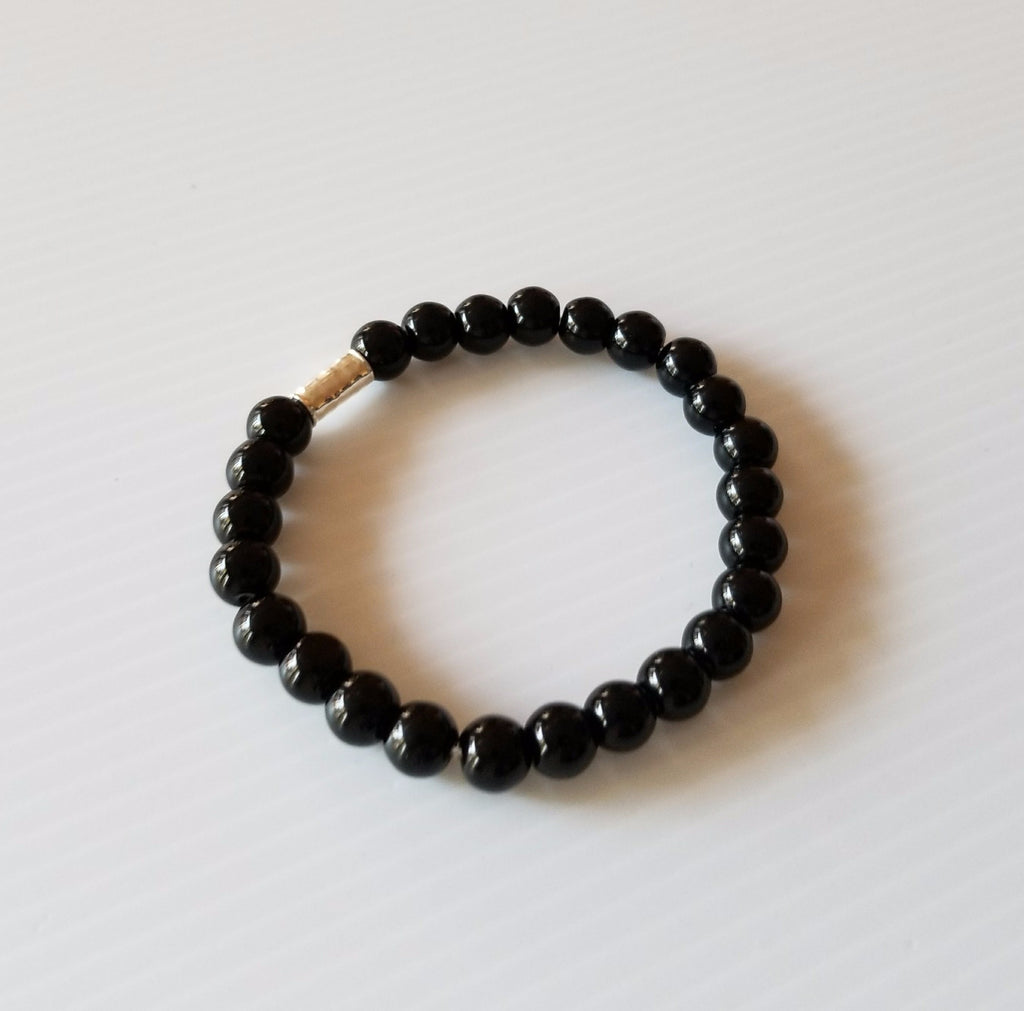 unisex stretch bracelet with black onyx beads and silver crimp clasp