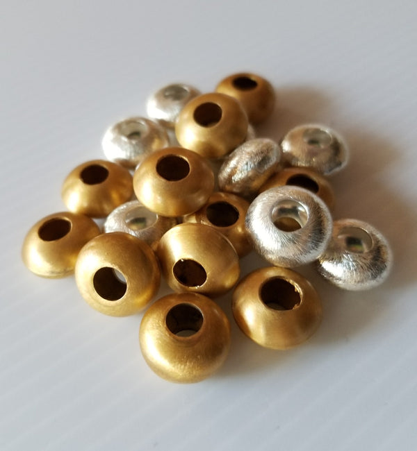 Pile of sterling silver and gold plated indora beads for use on necklaces and bracelets alone or with birthstone charms