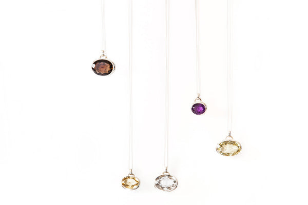 A collection of 5 Different TYI Pendants in TYI Signature Pendant, Amethyst, Yellow Quartz, Crystal Quartz, Black Onyx, Smoky Quartz, all from Thank You India