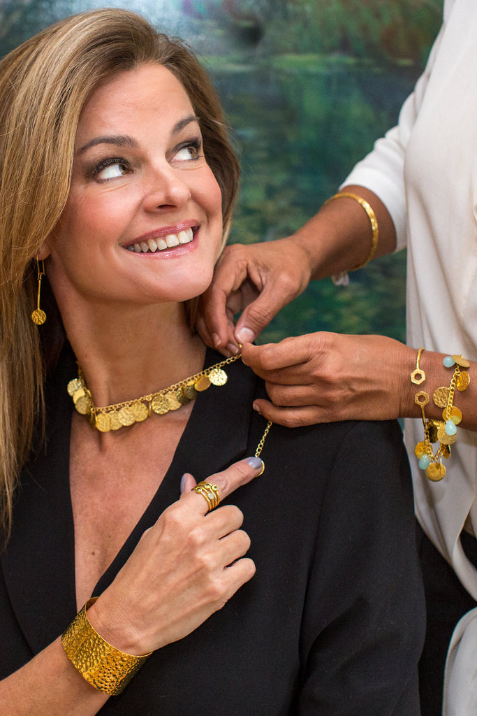gold hammered coin necklace, earrings, cuff styled on model