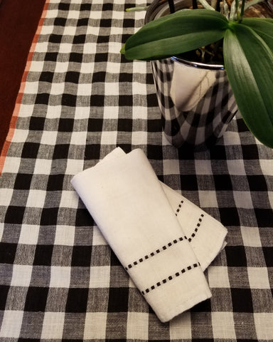 white linen kitchen tea towel with black laddering handwoven in india