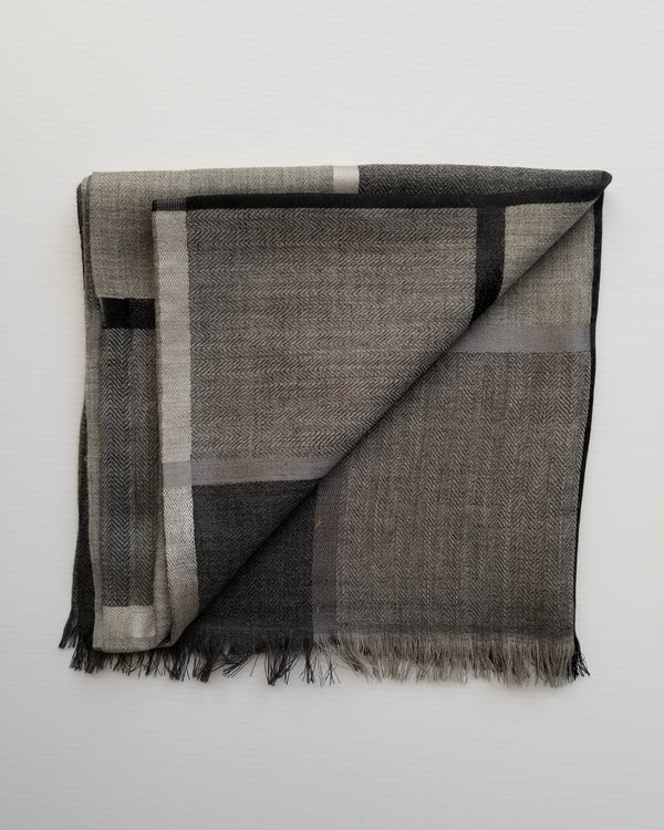 beautiful muted grey cotton with silk scarf folded on table